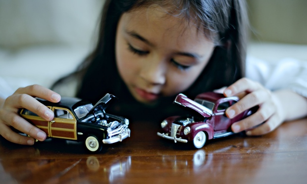 girl-plays-with-toy-cars-012.jpg