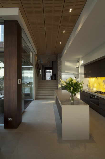 Kitchen-Design-and-Layout-at-Modern-Waterfront-House-Design-by-Bruce-Stafford-Architects.jpg