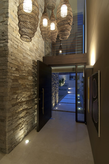 Stone-Wall-and-Cool-Hanging-Lamp-at-Modern-Waterfront-House-Design-by-Bruce-Stafford-Architects.jpg