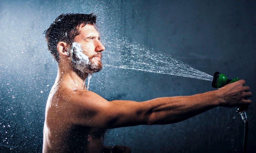 man-washing-his-beard-with-a-garden-hose.jpg