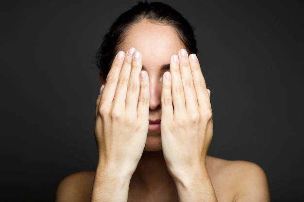 young-woman-covering-half-of-her-face-with-a-hand_1301-4021.jpg