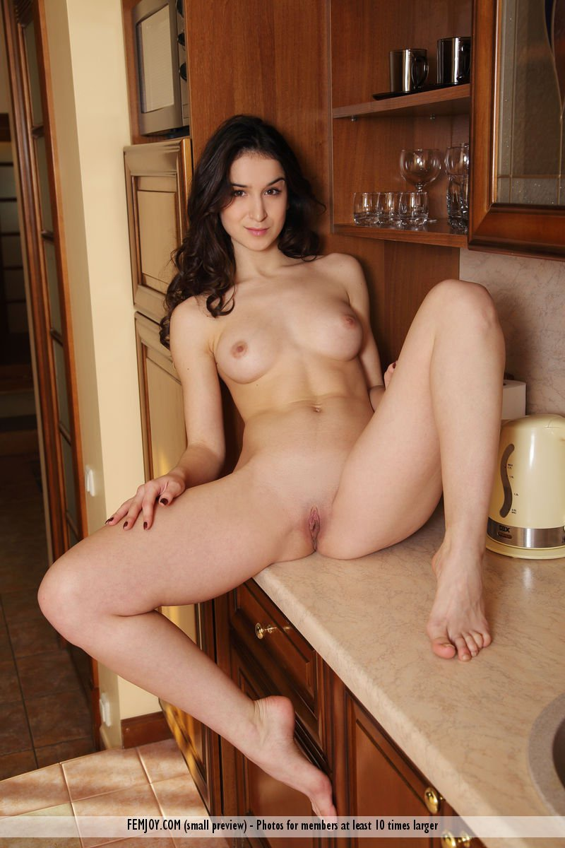 shaved-babe-tina-tin-with-meaty-labia-in-kitchen-1.jpg