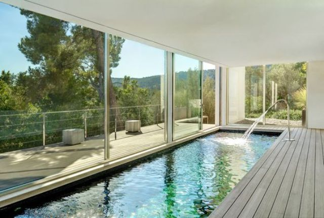 19-long-and-narrow-indoor-pool-with-a-wooden-deck-and-views.jpg