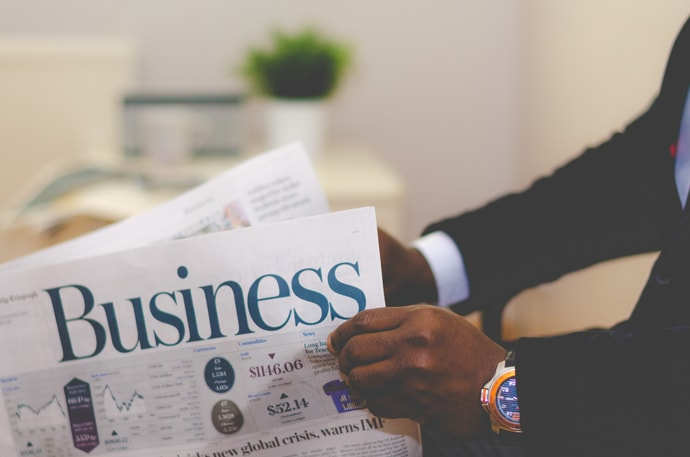 entrepreneur-reading-business-newspaper.jpg