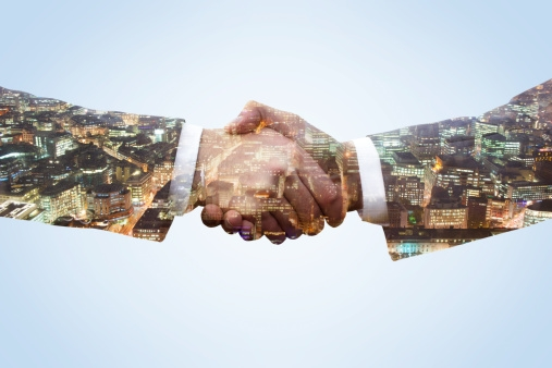 business-men-shaking-hands-by-tim-robberts.jpg