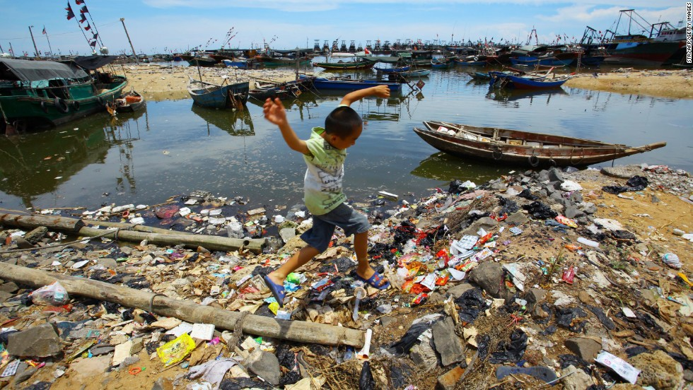 140624165225-chinese-boy-ocean-trash-horizontal-large-gallery.jpg