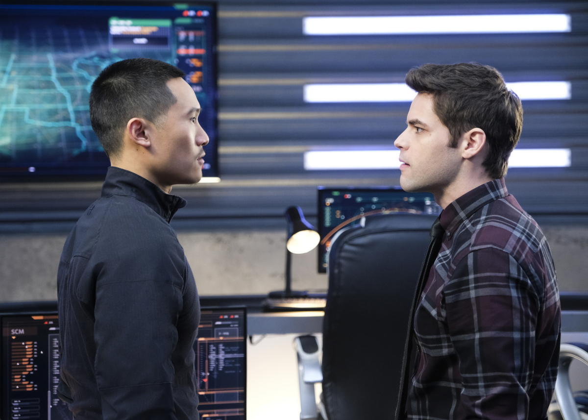 Supergirl -- 'In Search of Lost Time' -- Image Number: SPG315a_0290.jpg -- Pictured (L-R): Curtis Lum as Agent Demos and Jeremy Jordan as Winn -- Photo: Robert Falconer/The CW -- © 2018 The CW Network, LLC. All Rights Reserved.