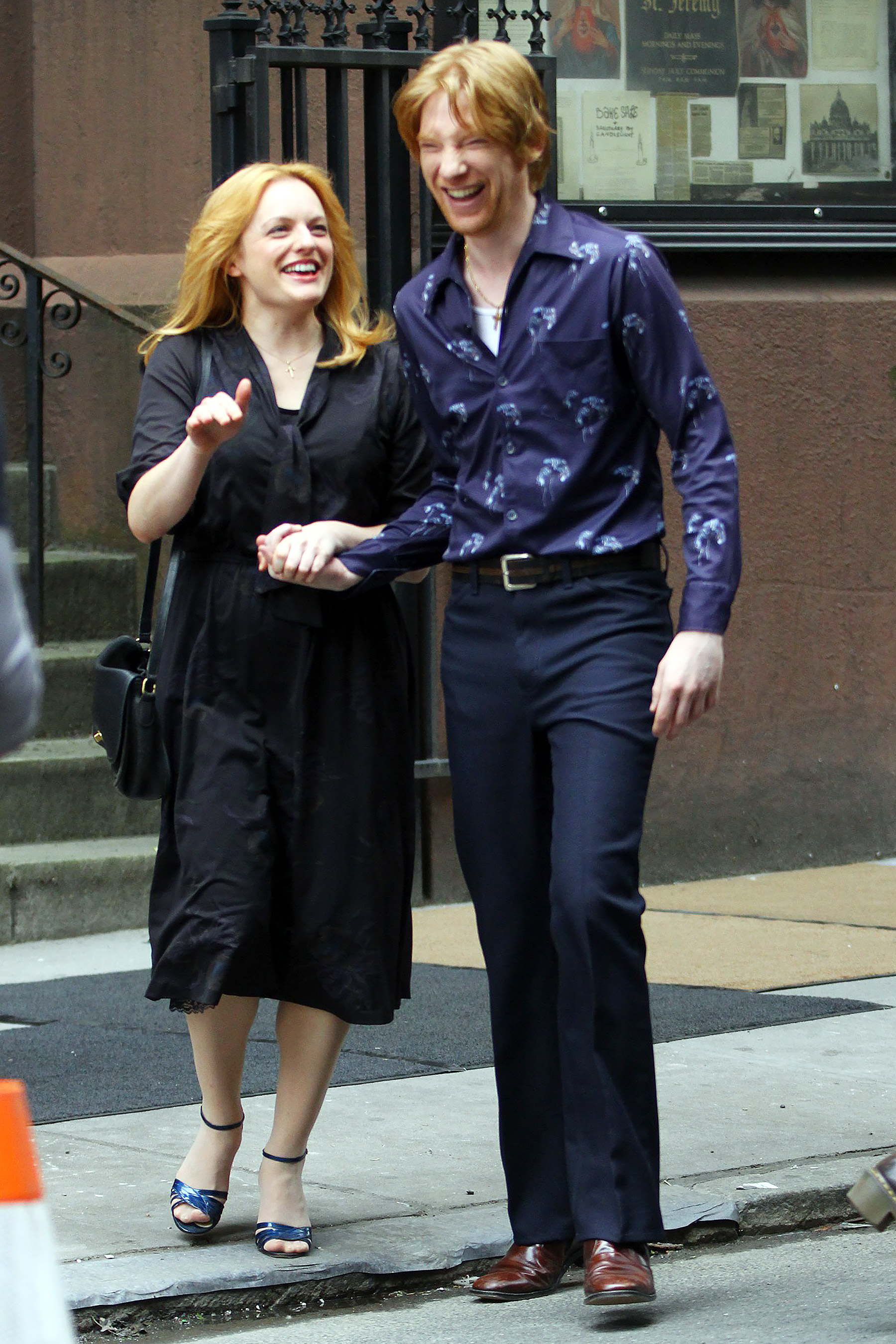 Elisabeth Moss and Domhnall Gleeson are caught in a candid moment while filming The Kitchen.