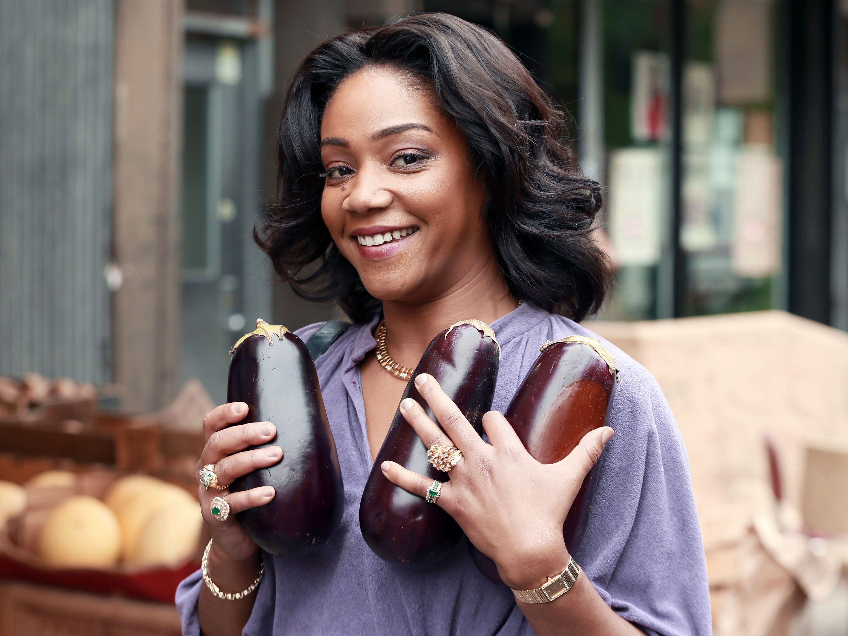 Tiffany Haddish embraces a trio of eggplants on the N.Y.C. set of The Kitchen.