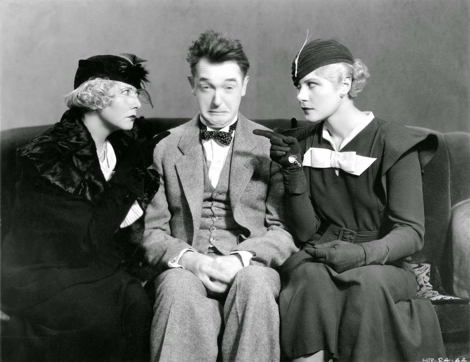 mae_busch_stan_laurel_and_dorothy_christy_in_sons_of_the_desert_1933.jpg