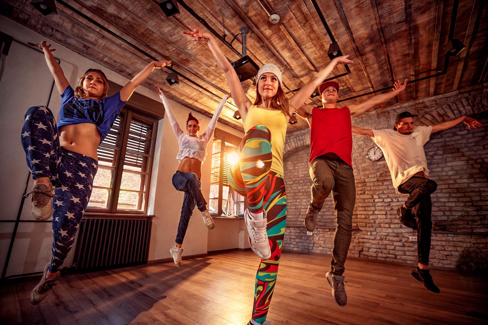 bigstock-young-modern-dancing-group-pra-228745360.jpg