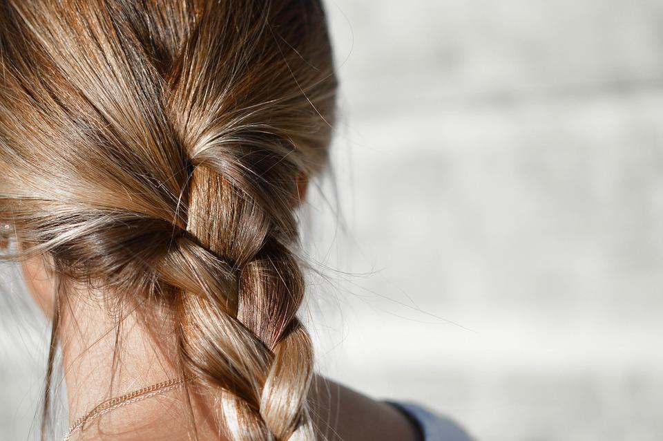blur-brunette-female-fashion-braided-hair-close-up-1853957.jpg