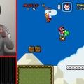 Orrával játszik Super Mario Worldöt egy japán férfi