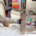 Csomagolóanyagból játék könyvtár