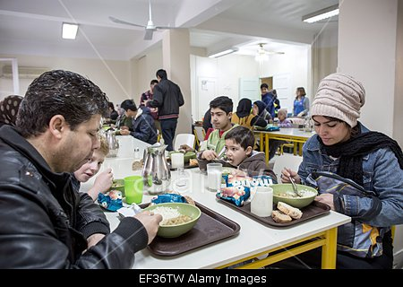 epa04578255-people-eat-in-a-caritas-soup-kitchen-in-athens-greece-ef36tw.jpg