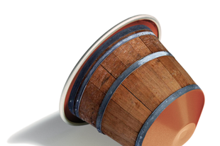 Meet Nespresso BARRIQUE - a coffee aged and sold in oak barrel capsules