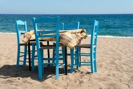 7975093-greek-beach-with-traditional-blue-table-and-chairs.jpg