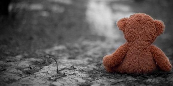 teddy-bear-sitting-alone-on-road.jpg
