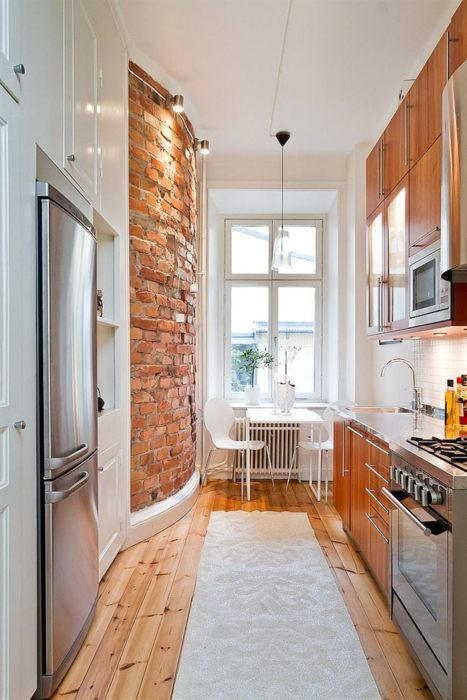 beautiful-curved-exposed-brick-wall-in-this-small-modern-kitchen.jpg