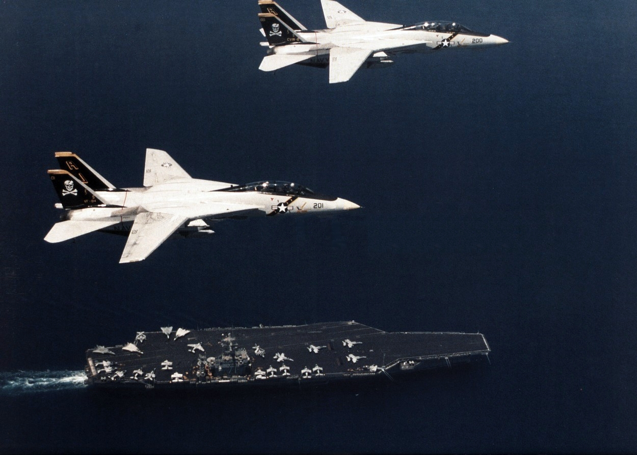 f-14as_vf-84_flying_over_uss_theodore_roosevelt_cvn-71_1989.jpg