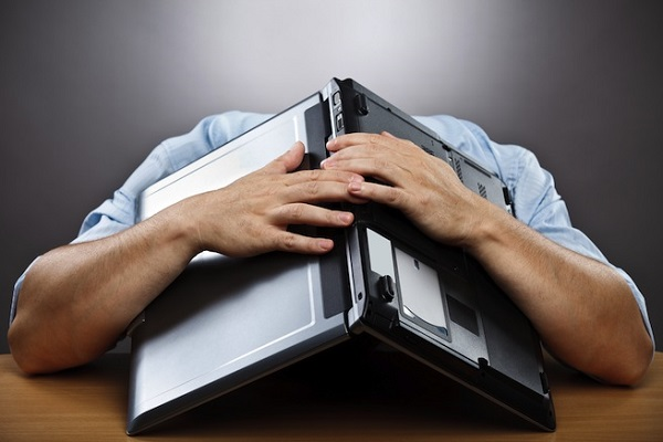 sad-depressed-man-on-computer.jpg