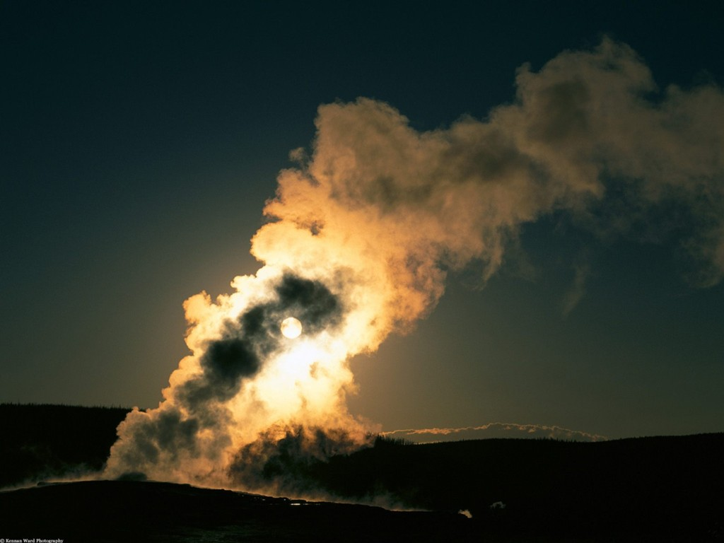 Old Faithful Geyser at Sunset, Yellowstone Natio.jpg