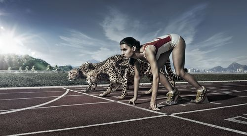 marathon_runner_girl_with_cheetah_on_race_start_line-wide.jpg