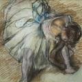 Dancer Adjusting Her Shoe