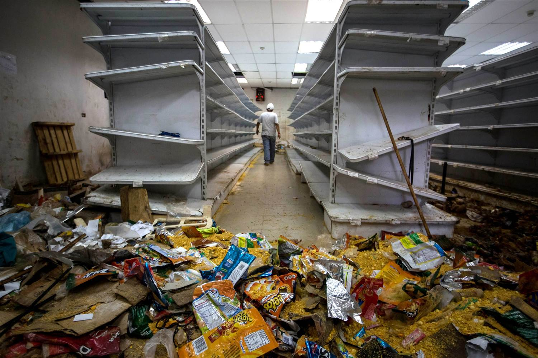 170105-venezuela-looting-412p-rs_3b8396146ae62a32a0ec68fcdc194ac4_nbcnews-ux-2880-1000.jpg