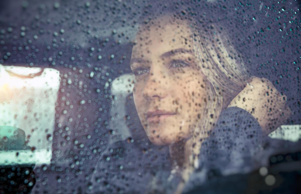 beautiful-sad-woman-in-the-car-dkv36rf.jpg