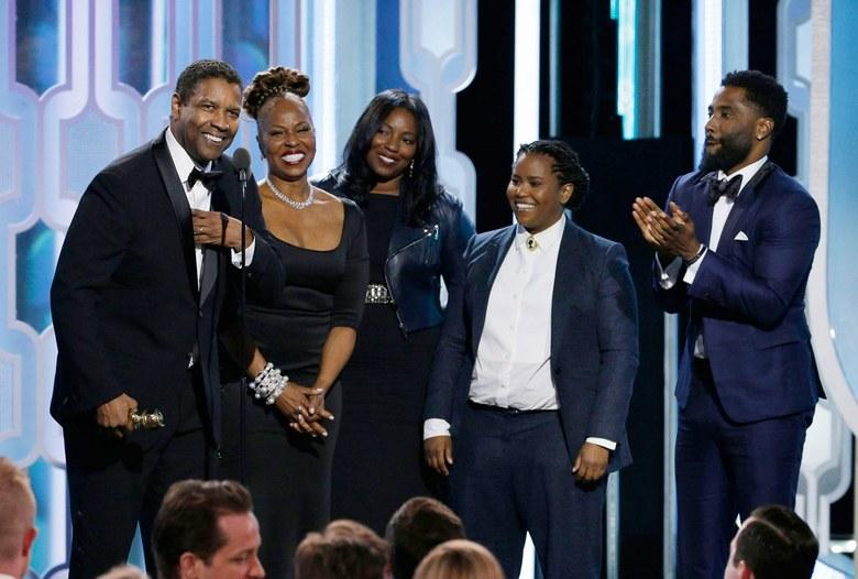 A Golden Glob díjátadón feleségével és 3 gyermekével, Malcolm fia nem volt ott, mert vizsgázott