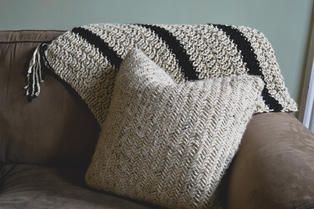 herringbone-striped-knitted-blanket-and-pillow.png
