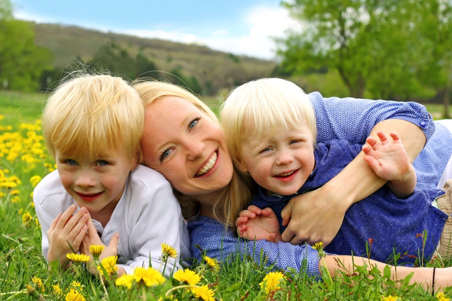 happy-mother-and-children-playing-outside.jpg