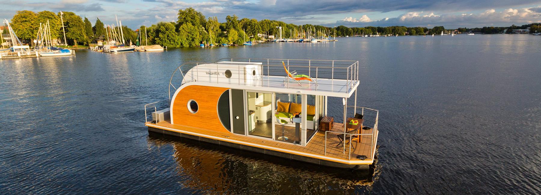 nautilus-hausboote-floating-home-designboom-header.jpg