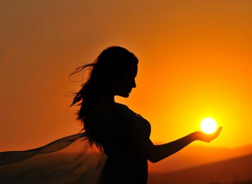 girl-holding-sun--large-msg-129961562717.jpg