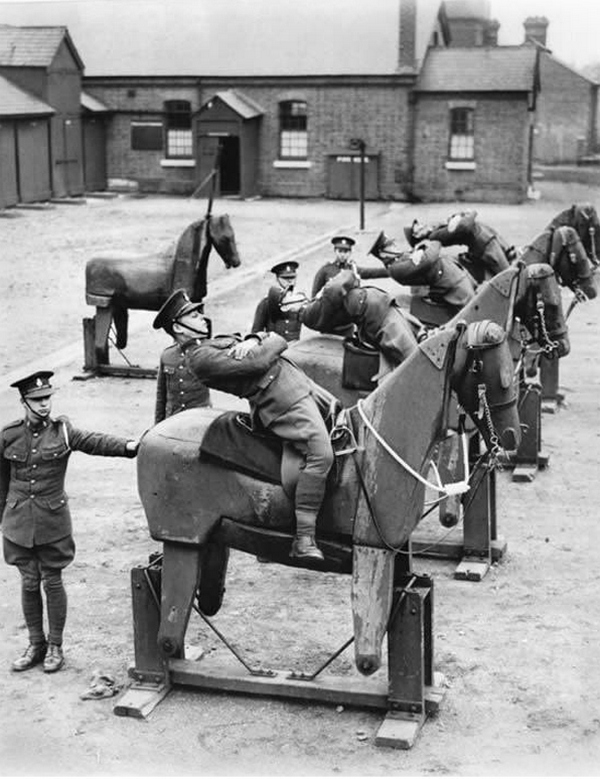 1935_new_recruits_of_the_7th_the_kings_own_hussars_regiment_practice_balancing_on_wooden_horses.jpg