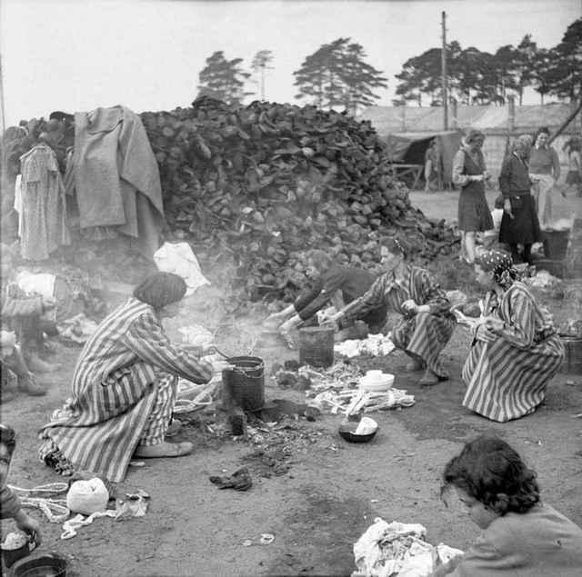1945_survivors_of_bergen_belsen_concentration_camp_use_shoes_to_fuel_fire.jpg