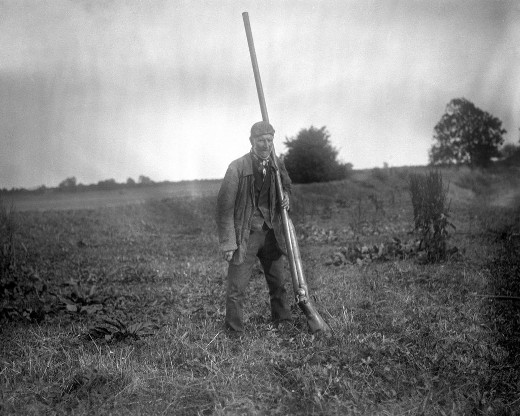 1868_a_man_with_a_punt_gun_a_type_of_large_shotgun_used_for_duck_hunting_it_could_kill_over_50_birds_at_once_and_was_banned_in_the_late_1860s.jpg