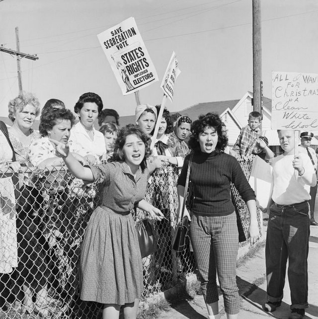 1960_segregationists_protest_the_attendance_of_6-year-old_ruby_bridges_at_william_frantz_elementary_school_new_orleans.jpg