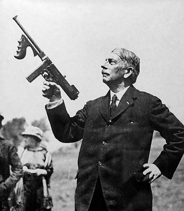 1921_general_john_taliaferro_thompson_holding_the_thompson_sub_machine_gun.jpg