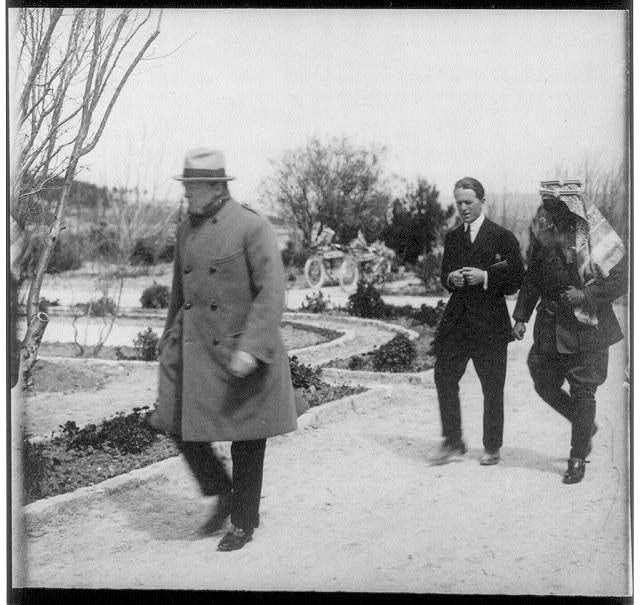 1921_winston-churchill-_lawrence-of-arabia_-and-emir-abdullah-walking-in-the-gardens-of-the-government-house-jerusalem-during-secret-conference_-1921.jpg