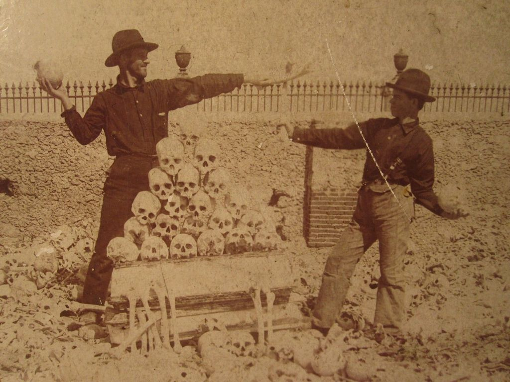 1899_american_soldiers_playing_around_with_human_skulls_in_colon_cemetery_in_havana.jpg