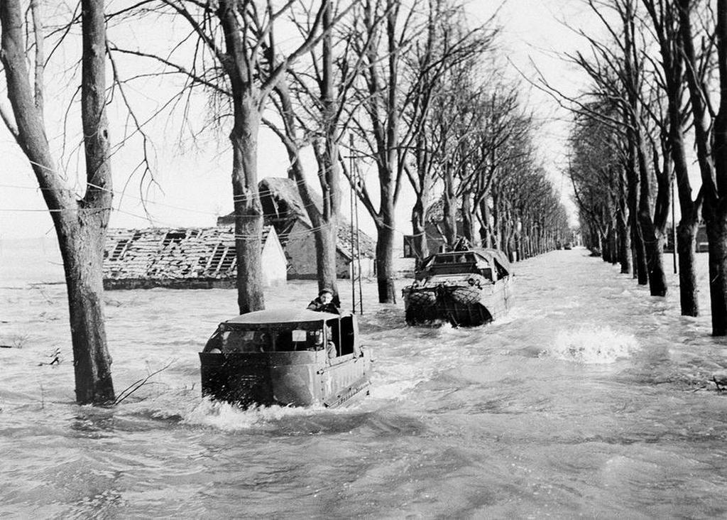 1945_februar_the_main_road_in_kranenburg_on_february_22_1945_amid_four-foot_deep_floods_caused_by_the_bursting_of_dikes_by_the_retreating_germans.jpg