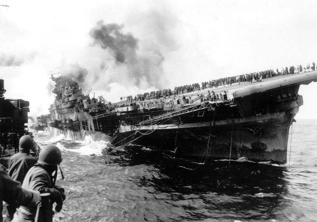 1945_marcius_19_the_uss_santa_fe_lies_alongside_the_heavily_listing_uss_franklin_to_provide_assistance_after_the_aircraft_carrier_had_been_hit_and_set_afire_by_a_single_japanese_dive_bomber.jpg