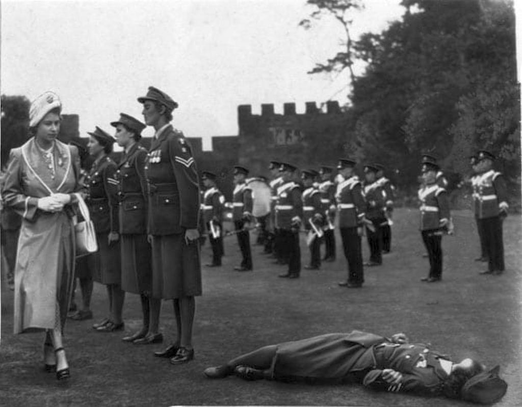 1949_princess_elizabeth_looks_with_concern_at_a_member_of_the_women_s_royal_army_corps_who_had_fainted.jpg