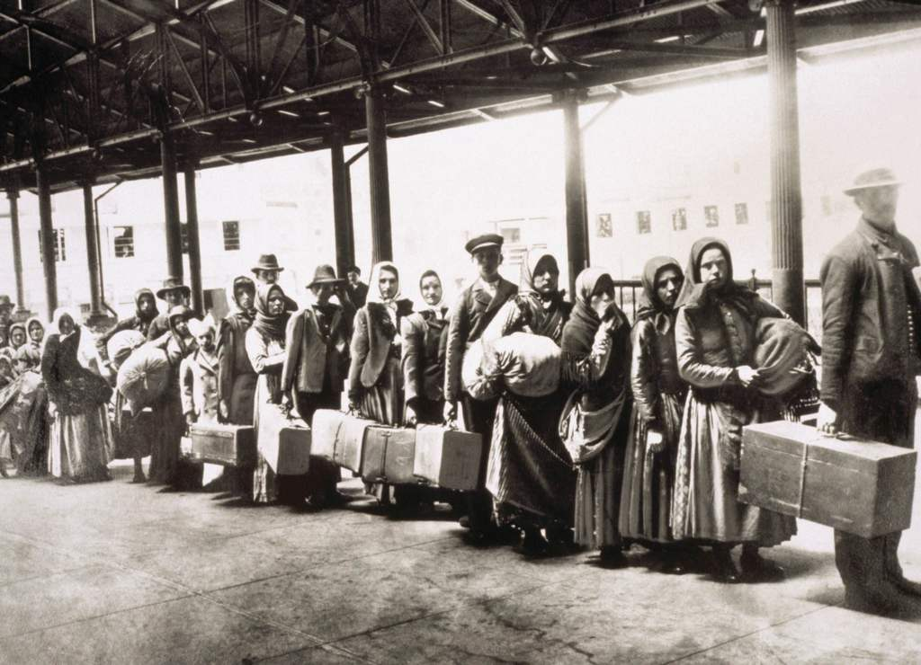 1905_immigrants_at_ellis_island_wait_for_the_ferry_to_take_them_into_new_york.jpg