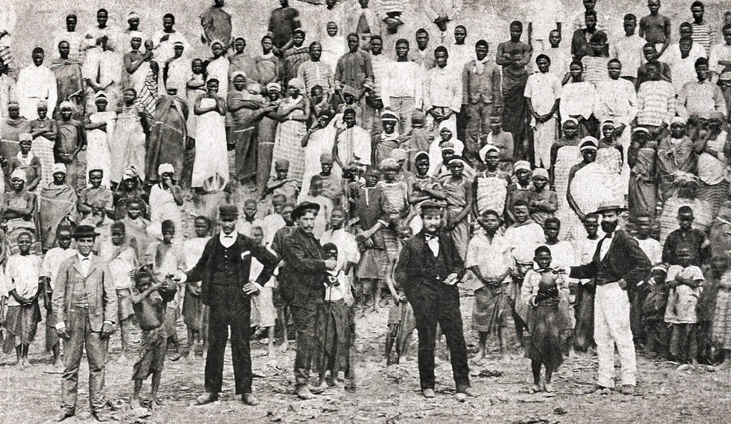 1885_slaves_and_their_masters_in_a_coffe_farm_in_rio_de_janeiro_brazil.jpg