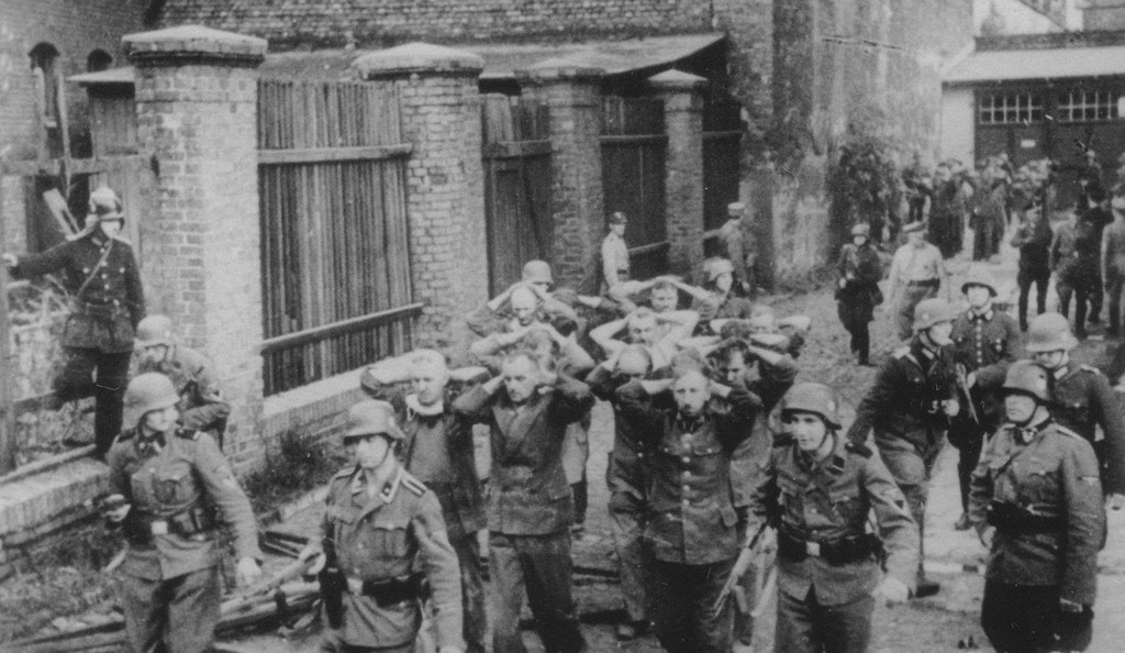 1939_gdansk_1st_september_polish_post_office_workers_being_transporters_by_german_soldiers_after_defending_the_polish_post_office_exec_okt_5.jpg