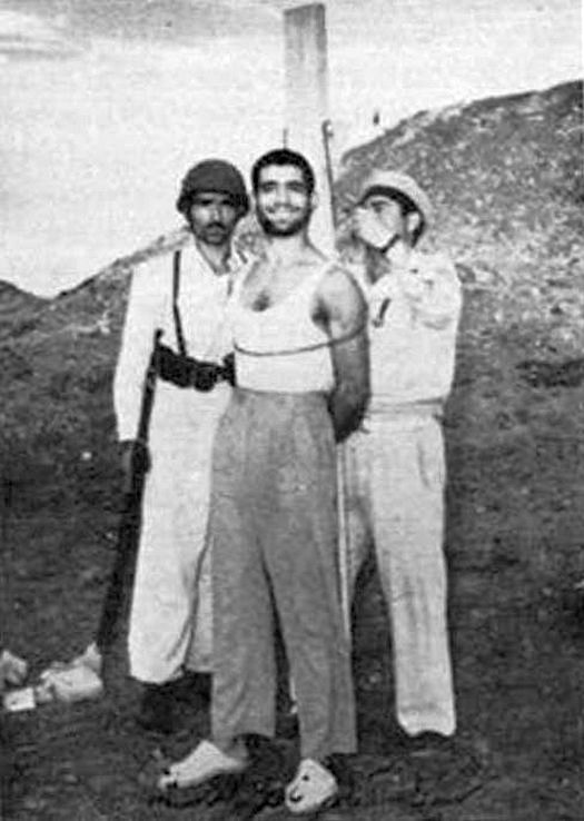 1953_during_the_events_of_the_coup_an_officer_of_iran_navy_is_smiling_right_before_being_executed_tehran.jpg