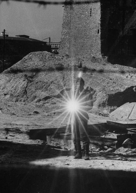 1961_east_german_policeman_uses_sunlight_reflected_off_a_mirror_in_an_attempt_to_stop_photographers_from_taking_pictures.jpg